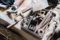 Still life tool box with nails rasp and old tools.  stock images