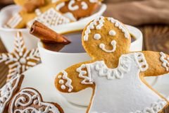 The still life on topic Christmas or New Year - Homemade christmas gingerbreads with a cup of coffee. On wooden boards Royalty Free Stock Photography