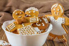 The still life on topic Christmas or New Year - Homemade christmas gingerbreads in a cup. On wooden boards Royalty Free Stock Images