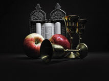 Still-life with Torah. A scroll of a Torah with apples and wines-glasses for wine stock images
