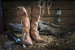 Still life with traditional leather boots in barn studio Stock Images