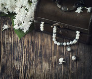 Still life with treasure chest and pearl necklaces. Stock Photos