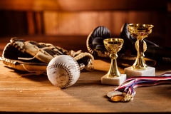 Still life of trophy, medals and vintage boxing gloves Royalty Free Stock Photography