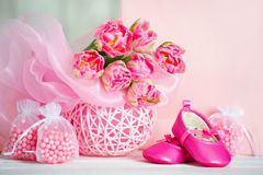 Still life with tulips and baby shoes Royalty Free Stock Photography