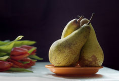 Still Life with Tulips and Pears Stock Photos