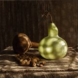 Still life with two pumkins and nuts with shadows.  Stock Images