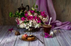 Two cakes, a bouquet of flowers and a cup of coffee Stock Image