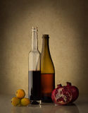 Still life with two wine bottles and fruits Royalty Free Stock Photo