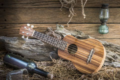 Still life with ukulele on barn studio background. Srill life photography with ukulele in vintage ranch barn studio background Royalty Free Stock Images