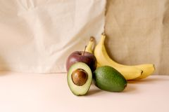 Still life of banana, avacado and apple stock image
