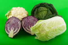 Still life various cabbages on green background Royalty Free Stock Photography