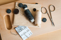 Still life various sewing accessories on board royalty free illustration