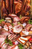 Still life of various smoked pork meat Stock Photos