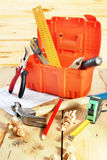 Still life with various working tools on the wooden table Stock Photography