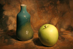 Still life with vase and apple. Over abstract background Royalty Free Stock Photography