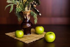 Still life vase and apples. Still life vase with spikelets of wheat and apples Stock Photography
