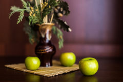 Still life vase and apples. Still life vase with spikelets of wheat and apples Stock Photos