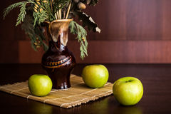 Still life vase and apples. Still life vase with spikelets of wheat and apples Royalty Free Stock Photography