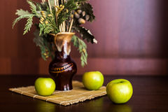 Still life vase and apples. Still life vase with spikelets of wheat and apples Royalty Free Stock Photos