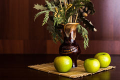 Still life vase and apples. Still life vase with spikelets of wheat and apples Royalty Free Stock Photo