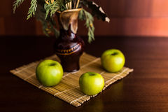 Still life vase and apples. Still life vase with spikelets of wheat and apples Stock Photo