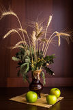 Still life vase and apples. Still life vase with spikelets of wheat and apples Royalty Free Stock Images