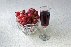 Still life vase with grapes and a glass of wine stock images