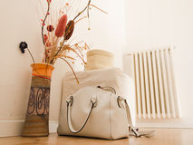 Still life with vase , handbag, pouf and heater Stock Photography