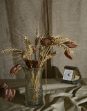 Still life with a vase and a an old table clock. Royalty Free Stock Image