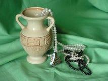 Still life. Vase. Pearl. Ring. stock image
