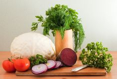 Still life of vegetables. And herbs on a cutting board Royalty Free Stock Photography