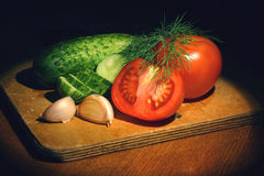 Still Life with Vegetables. Tomatoes, cucumbers, garlic Stock Photo