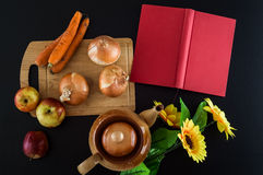 Still life with vegetables on black background, top view Royalty Free Stock Image