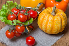 Still life with vegetables, decorative pumpkins and cherry tomat Royalty Free Stock Image