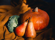 Still life with vegetables and fruits on the background of cozy Stock Photo