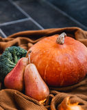 Still life with vegetables and fruits on the background of cozy Stock Photography
