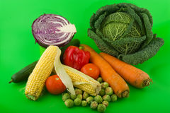Still life vegetables on green background Stock Photo