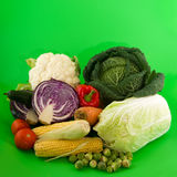 Still life vegetables on green background Royalty Free Stock Photo