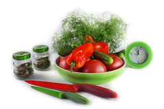 Still life with vegetables at kitchen accessories. Still life with vegetables, knives, a frying pan and spices on a light background Stock Photo