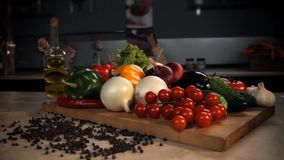 Still life of vegetables in the kitchen interior.  Panorama stock footage