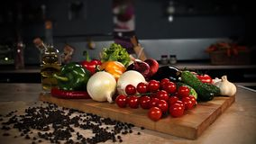 Still life of vegetables in the kitchen interior.  Panorama stock video footage