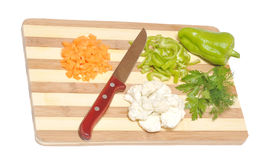 Still life of vegetables and kitchen-knife Stock Image
