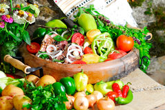 Still life vegetables and meat. Still life from vegetables and meat on the earthen dish in ethnic style Stock Photo