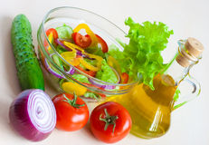 Still life with vegetables for salad with oil Royalty Free Stock Photo
