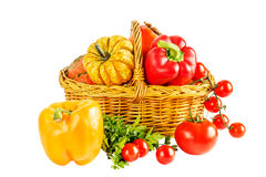 Still life with vegetables in a wicker basket on a white backgro Royalty Free Stock Photos