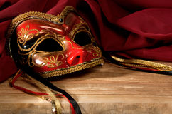 Still life with Venetian carnival mask. Stock Photos