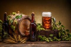 Vintage beer barrel. Still life of vintage beer barrel and green hops Stock Photo