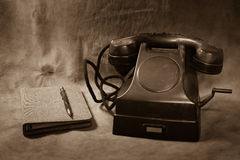 Still life Vintage black phone. Phone Book sepia tone Stock Images