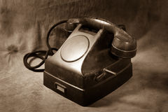 Still life  Vintage black phone. Sepia tone Stock Photo
