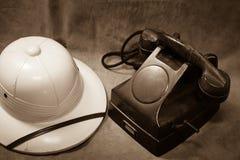 Still life Vintage black phone, Vintage hat. Sepia tone Stock Images